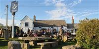 Visit one of the best pubs in Dorset for live music, great drink and its very own Stonehenge...