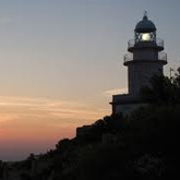 Travel to Cabo San Antonio to view the protected marine reserve and lighthouse