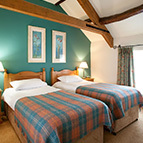 Twin beds in holiday cottage